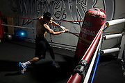 Amir Khan works out with a baseball bat during a session with Alex Ariza.<br /> Exclusive Amir Khan shoot for SEEN Sport Magazine at the Wildcard Gym, Los Angeles, USA. 3rd November 2010.