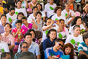 "15 JUNE 2014 - BANGKOK, THAILAND:  People watch a police band perform in Lumpini Park in Bangkok. The Thai military junta, formally called the National Council for Peace and Order (NCPO), is sponsoring a series of events throughout Thailand to restore ""Happiness to Thais."" The events feature live music, dancing girls, military and police choirs, health screenings and free food.  PHOTO BY JACK KURTZ"