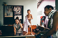 Kanlaya Chaiwarae and her youngest son at their home in Rayong, Thailand.