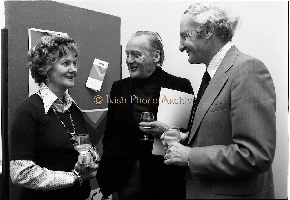 5/07/1977<br /> 07/25/1977<br /> 25 July 1977<br /> ROSC '77 Press Reception at Peter Owens Ltd. <br /> Dr. Marie dePaor, archaeologist; Dr. Michael Scott, Chairman ROSC '77 committee and Mr William O'Loghlen, Director of the Bank of Ireland, one of the sponsors of ROSC '77, photographed at the press reception to announce the details of the forthcoming exhibition in Dublin.