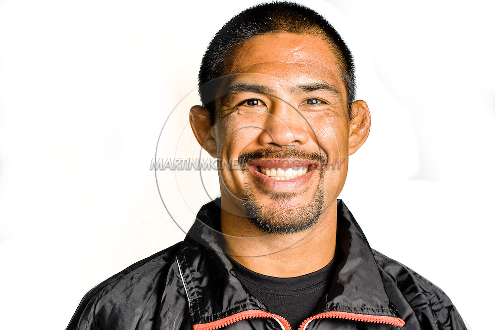 "MANCHESTER, ENGLAND, NOVEMBER 23, 2013: Mixed martial arts athlete Mark Munoz poses for a portrait following the media open work-out sessions for ""UFC Fight Night 30: Machida vs. Munoz"" inside Bierkeller Shooter's Sports Bar in The Printworks, Manchester (Martin McNeil for ESPN)"