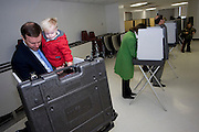 CHESHIRE, CT - 02 NOVEMBER 2010 -.U. S. Rep. Chris Murphy (D-5th) holds his son Owen as Murphy and wife Cathy vote at Cheshire High School on Tuesday morning. Murphy is challenged by Conn. Sen. Sam Caligiuri (R-16th)..Photo by Josalee Thrift