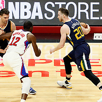 15 April 2017: Utah Jazz forward Gordon Hayward (20) drives past Utah Jazz center Jeff Withey (24) on a screen set by LA Clippers forward Luc Mbah a Moute (12) during the Utah Jazz 97-95 victory over the Los Angeles Clippers, during game 1 of the first round of the Western Conference playoffs, at the Staples Center, Los Angeles, California, USA.