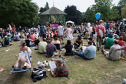 Crowd of people sitting on the grass at Nottingham's 2005 Gay Pride Lesbian festival; held at the Arboretum,
