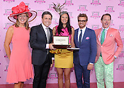Jennifer Judkins, left, and Juan-Carlos Capelli, second left, both of Longines, along with celebrity judges Simon Baker, second right, and Carson Kressley, right, present Criselda Breene, center, of Miami Beach, Fl. with her prize, a Longines timepiece from the Conquest Classic Collection, after she won the Longines Kentucky Oaks Fashion Contest on Kentucky Oaks Day, Friday, May 2, 2014, in Louisville, Ky.  Longines, the Swiss watch manufacturer known for its luxury timepieces, is the Official Watch and Timekeeper of the 140th annual Kentucky Derby. (Photo by Diane Bondareff/Invision for Longines/AP Images)