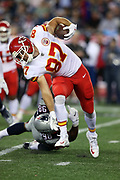 Kansas City Chiefs tight end Travis Kelce (87) twists his body as he breaks a tackle attempt by New England Patriots defensive end Trey Flowers (98) after catching a pass good for a gain of 7 yards during the 2017 NFL week 1 regular season football game against the New England Patriots, Thursday, Sept. 7, 2017 in Foxborough, Mass. The Chiefs won the game 42-27. (©Paul Anthony Spinelli)