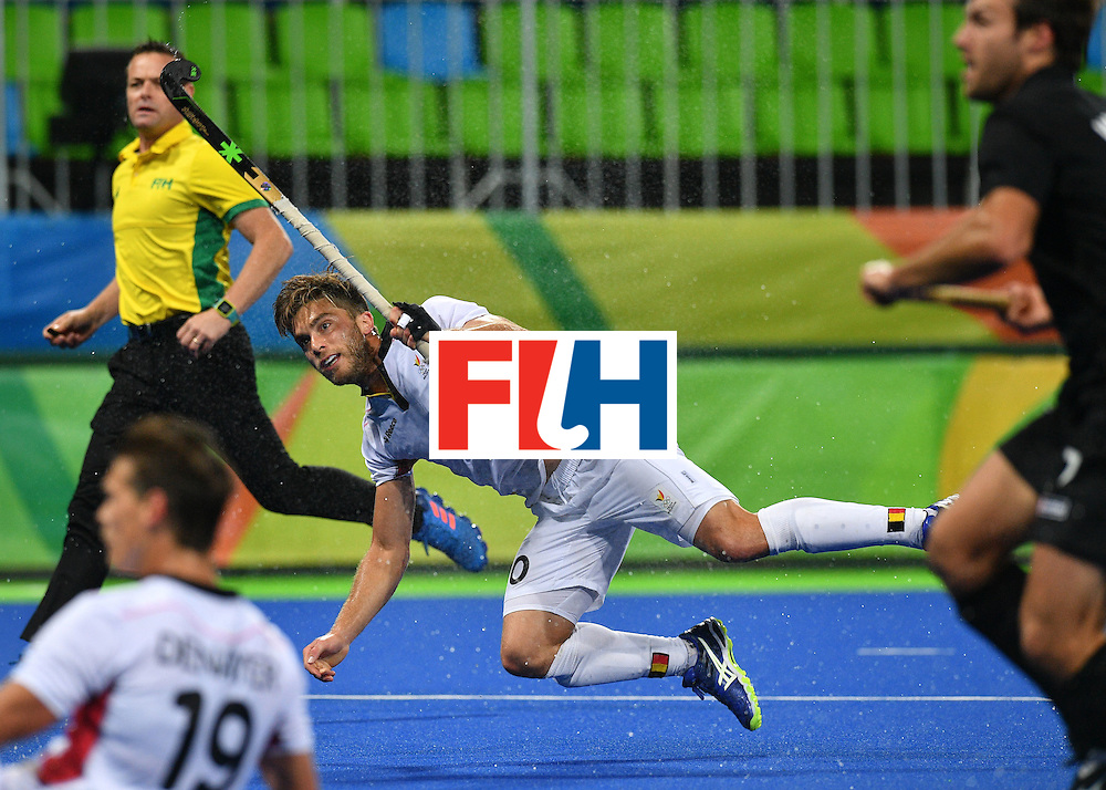Belgium's Cedric Charlier (C) shoots during the mens's field hockey Belgium vs New Zealand match of the Rio 2016 Olympics Games at the Olympic Hockey Centre in Rio de Janeiro on August, 12 2016. / AFP / Carl DE SOUZA        (Photo credit should read CARL DE SOUZA/AFP/Getty Images)