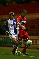 Photo: Andrew Unwin.<br /> Middlesbrough v Blackburn Rovers. Carling Cup. 21/12/2005.<br /> Blackburn's Morten Gamst Pedersen (L) watches Middlesbrough's Matthew Bates (R).