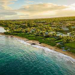 Maui Hawaii aerial drone photo of Mokapu Beach and Keawakapu Beach shoreline at sunrise. Mokapu Beach and Keawakapu Beach are popular destinations in Wailea-Makena Kihei Hawaii. Copyright ⓒ 2019 Paul Velgos with All Rights Reserved.