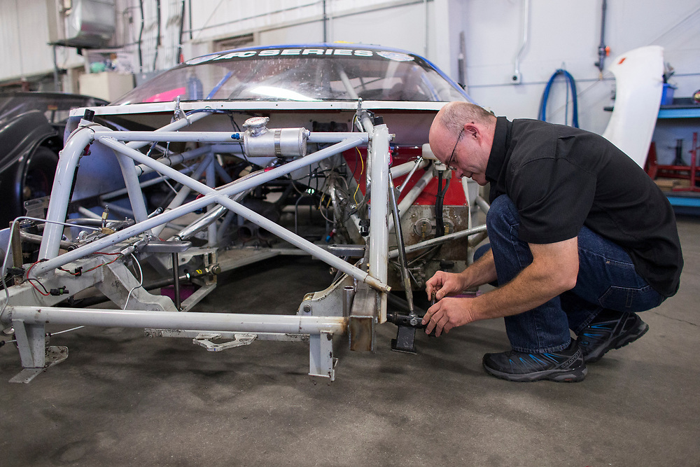 Mike McColl works on a car at McColl Racing Enterprises in London Ontario, Wednesday,  September 6, 2017.<br /> Business London/ Geoff Robins