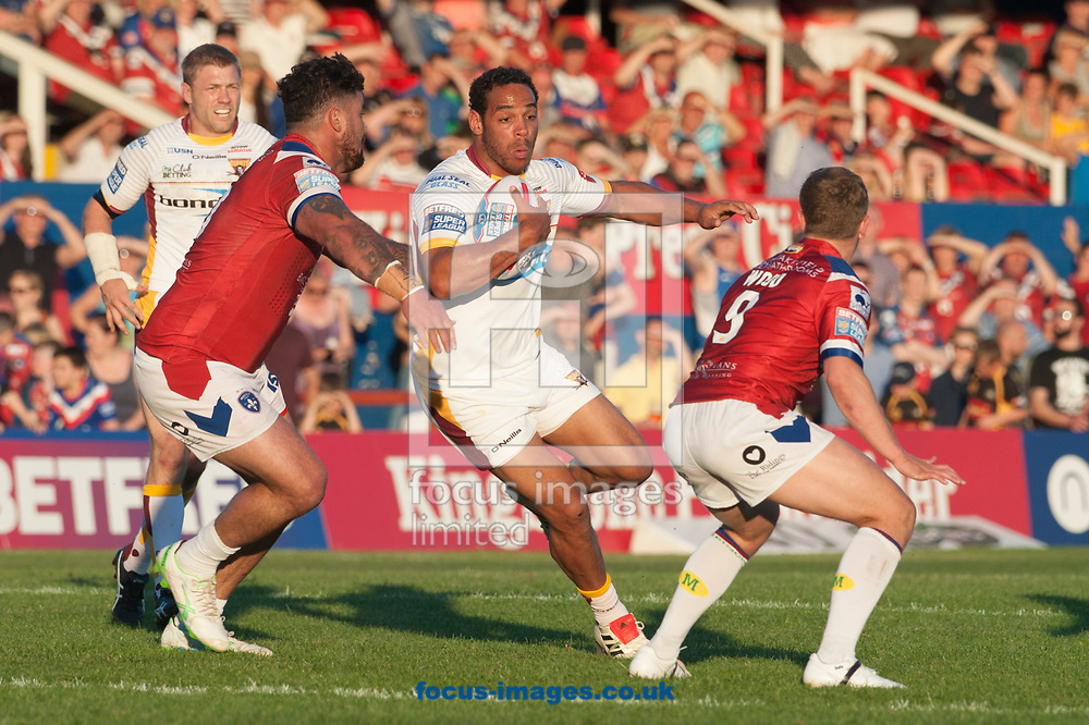 Leroy Cudjoe of Huddersfield Giants tries to find a way past David Fifita (left) and Kyle Wood of Wakefield Trinity during the Betfred Super League match at Belle Vue, Wakefield<br /> Picture by Matt Wilkinson/Focus Images Ltd 07814 960751<br /> 26/05/2017