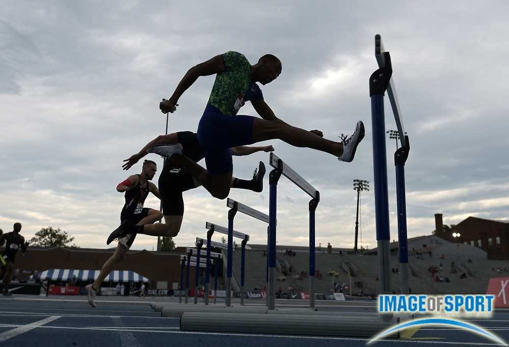 Jul 25, 2019; Des Moines, IA, USA; Silhouette of Amere Lattin in a 400m hurdles heat during the USATF Championships at Drake Stadium.