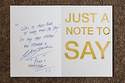 © Licensed to London News Pictures . 06/07/2017 . Manchester , UK . Card from Charles Salvador and Paula Williamson to Barbara Dransfield which accompanied £1,000 cash . Artwork by convicted criminal  Charles Salvador (previously Charles Bronson) has been sold on behalf of Salvador to raise a £1,000 to support Barbara and Len Dransfield . Barbara , who has become friendly with Salvador , was brought the money and a card by Salvador's fiance , Paula Wiliamson . Barbara Dransfield was brutally assaulted by masked robbers as she sat at home in her wheelchair . She suffered extensive injuries to her face and body . Photo credit : Joel Goodman/LNP