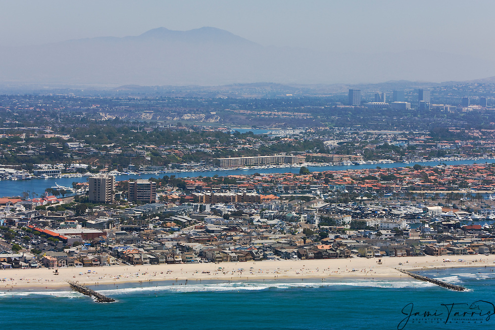 An aerial of Saddleback Mountain through the haze behind Newport Beach and the Pacific Ocean,Newport Beach,California,USA