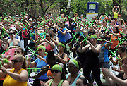 Thousands of attendees take part in the POUND class at SELF magazine's 21st annual Workout in the Park, Saturday, May 10, 2014, in New York's Central Park. (Photo by Diane Bondareff/Invision for SELF/AP Images)