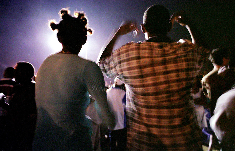 A couple dances during a free outdoor concert in Havana.