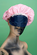 mannequin doll with sleeping mask and shower cap