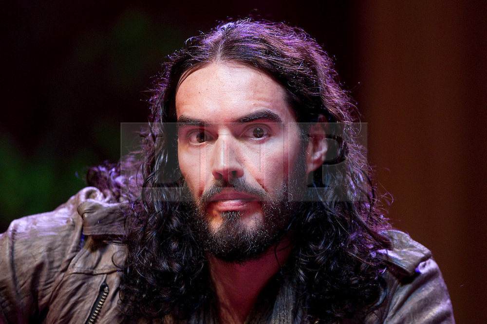 © Licensed to London News Pictures. 16/06/2012. Manchester , UK . Russell Brand at the Manchester Arena , Greater Manchester , at the Stand Up and Be the Change youth event . The Dalai Lama is on a 10 day tour of the UK . Photo credit : Joel Goodman/LNP