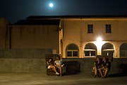 Full moon shines on the lazy couples, Alghero, July 8, 2017