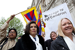 © Licensed to London News Pictures. 10/05/2012. LONDON, UK. Bianca Jagger and supporters make their way along Whitehall to urge UK Prime Minister David Cameron to support the Tibetan people. Photo credit: Matt Cetti-Roberts/LNP