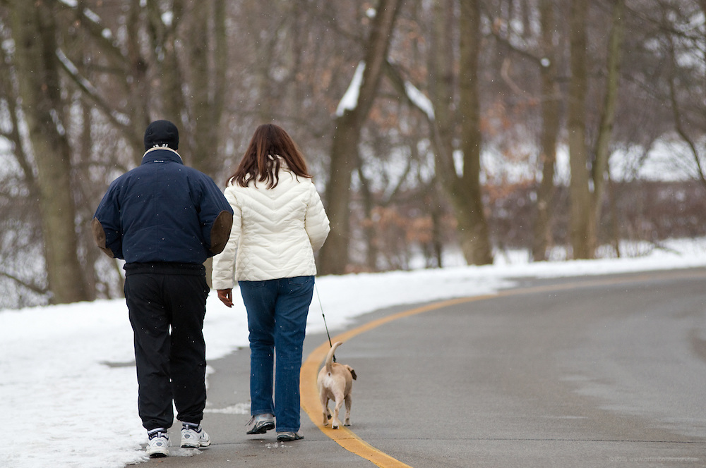 Jo Ann and Dan Santos walk Sadie, 4, their blind Puggle (a mix of Pug and Beagle) down from Dog Hill in Cherokee Park, Sunday, Feb. 14, 2010 in Louisville, Ky. (Photo by Brian Bohannon)