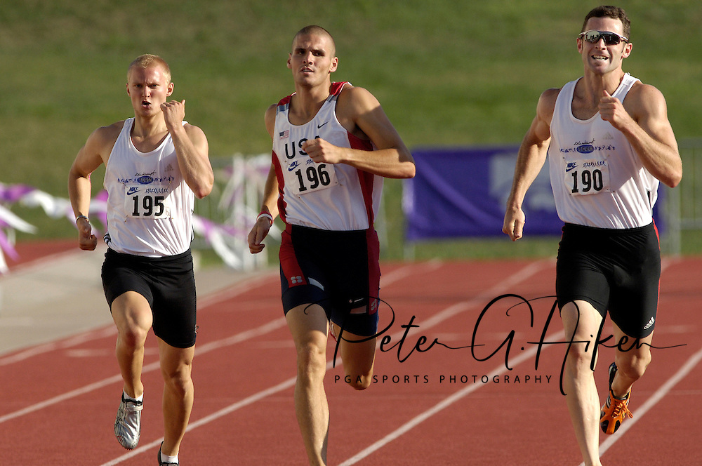 Germany's Johannes Schwuchow (195) sprints to the finish with teammate Lars Albert (190) and Chris Boyles (196) of the United States in the 400-meter dash, at the Nike Combined Events Challenge at the R.V. Christian Track Complex on the campus of Kansas State University in Manhattan, Kansas, August 5, 2006.