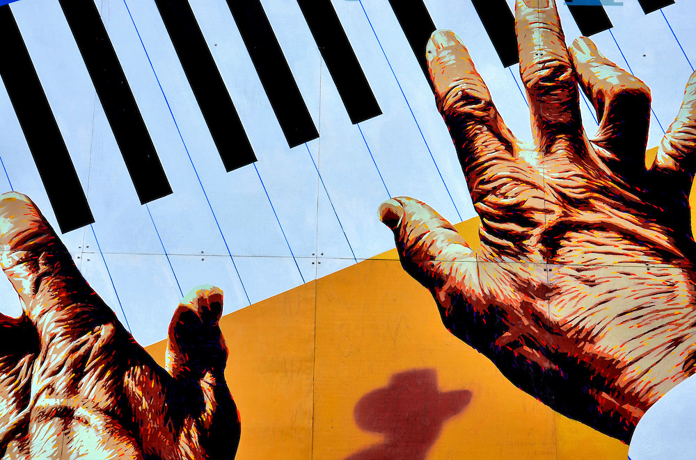 Old Hands Playing Piano Mural at Arkley Performing Arts in Eureka, California <br /> A wonderful season of symphony is played at The Arkley Center for the Performing Arts in Eureka, California.  And, before entering the concert hall, your senses are delighted by a very long wall mural by Randy Spicer in the parking lot on 5th and G Streets that includes this detail of old hands playing the piano.  A walking tour and maps are available for those who want to see the best of Erika&rsquo;s street art.