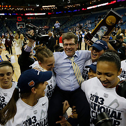 Apr 9, 2013; New Orleans, LA, USA; Connecticut Huskies head coach Geno Auriemma is lifted by his players after the championship game in the 2013 NCAA womens Final Four against the Louisville Cardinals at the New Orleans Arena. Connecticut defeated Louisville 93-60. Mandatory Credit: Derick E. Hingle-USA TODAY Sports