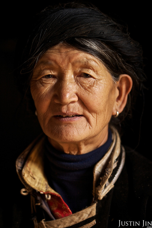 Portrait of Li (surname) La Cuo, 66, who belongs to the musui minority, at home near the legendary Lugu Hu Lake in Sichuan Province, southwestern China.