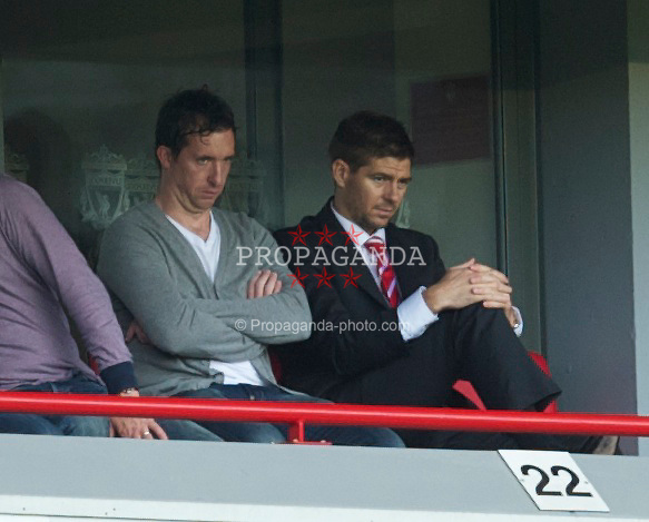 LIVERPOOL, ENGLAND - Sunday, May 15, 2011: Liverpool's captain Steven Gerrard MBE and former player Robbie Fowler watch from an executive box during the Premiership match against Tottenham Hotspur at Anfield. (Photo by David Rawcliffe/Propaganda)