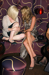 Left to right, KELLY OSBOURNE and KATE MOSS at a party to celebrate the opening of The Bar at The Dorchester, Park Lane, London on 27th June 2006.<br />