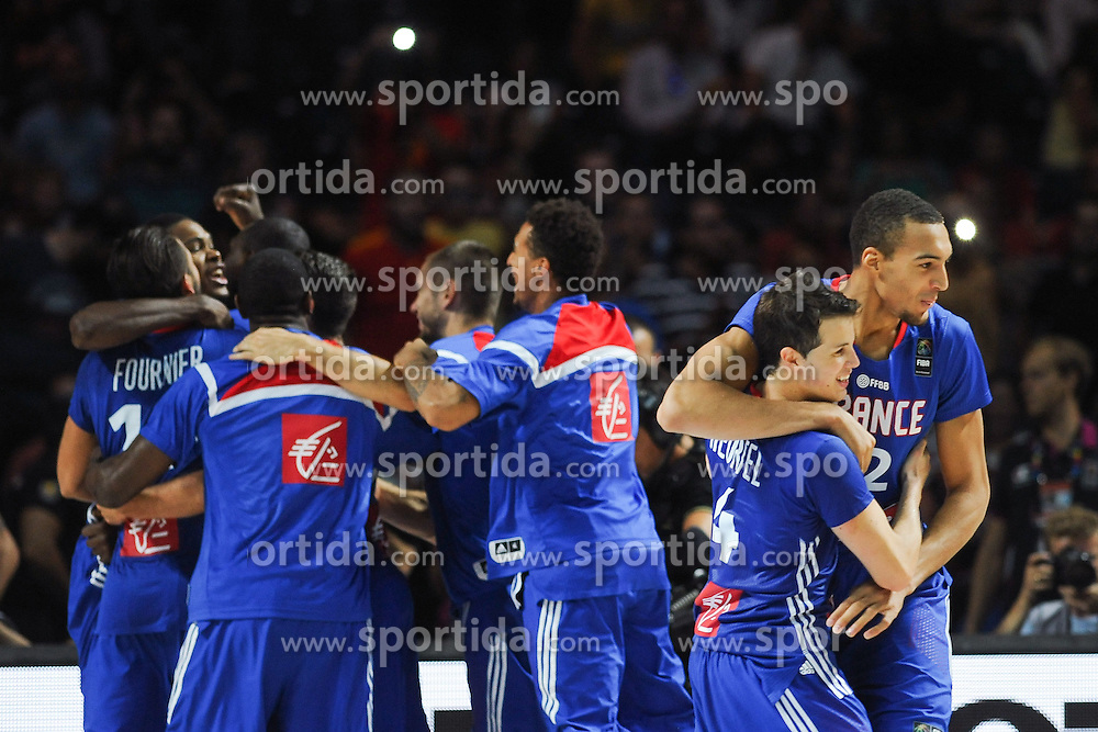 Players of France celebrate after winning during the 2014 FIBA World Basketball Championship Third Place match between France and Lithuania at the Palacio de los Deportes, on September 13, 2014 in Madrid, Spain. Photo by Tom Luksys  / Sportida.com <br /> ONLY FOR Slovenia, France