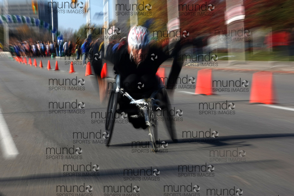 (Ottawa, ON---18 October 2008) A wheelchair competitor pushes for the finish in the 2008 TransCanada 10km Canadian Road Race Championships. Photograph copyright Sean Burges/Mundo Sport Images (www.msievents.com).