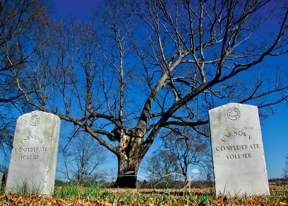 Two unknown Confederate soldiers are among several buried on the hillside behind the Civil War Interpretive Center in Corinth, Miss. The site was a Union stronghold during the Civil War. Thousands died when Confederates stormed Battery Robinette and attemped to retake Corinth on Oct. 3-4, 1862. The Interpretive Center, operated by the National Park Service as a unit of Shiloh National Battlefield, features interactive exhibits explaining Corinth's role in the war and the toll the fighting took on the Confederacy.  (Photo by Carmen K. Sisson/Cloudybright)