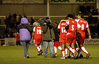 Photo: Leigh Quinnell.<br /> Hartlepool United v Swindon Town. Coca Cola League 1.<br /> 02/01/2006. A camera crew follows Swindon off the pitch filming a programe with Ron Atkinson.