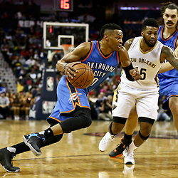 Feb 25, 2016; New Orleans, LA, USA; Oklahoma City Thunder guard Russell Westbrook (0) drives past New Orleans Pelicans forward Alonzo Gee (15) during the second quarter of a game at Smoothie King Center. Mandatory Credit: Derick E. Hingle-USA TODAY Sports