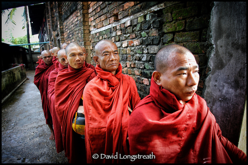 """In this """"Signature Series"""" image by David Longstreath Buddhist monks, many of them novices and oprhans, are seen at a Rangoon, Burma, monastery."""