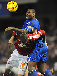Leicesters Wes Morgan holds of Forests Jamie Mackie, Nottingham Forest v Leicester City, City Ground Nottingham,  Sky Bet Championship, 19th Febuary 2014