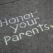 Chalk Street Artist Quote &quot; Honor Your Parents&quot;. <br />