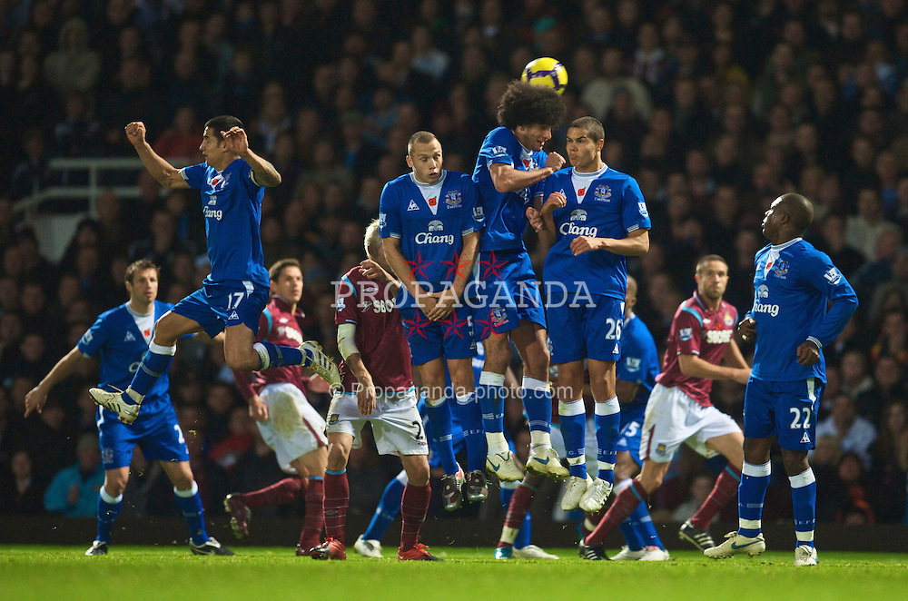 LONDON, ENGLAND - Sunday, November 8, 2009: Everton's John Heitinga, Marouane Fellaini and Jack Rodwell defend a West Ham United free-kick during the Premiership match at Upton Park. (Photo by David Rawcliffe/Propaganda)