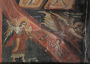 Fresco of sinners in a river of fire and angel spearing them with a trident, from the Day of Judgement in the narthex of the Holy Resurrection Church or Kisha e Ristozit, 14th century, Mborje, Korce, Albania. The church, dedicated to St Mary, is a Cultural Monument of Albania. Picture by Manuel Cohen