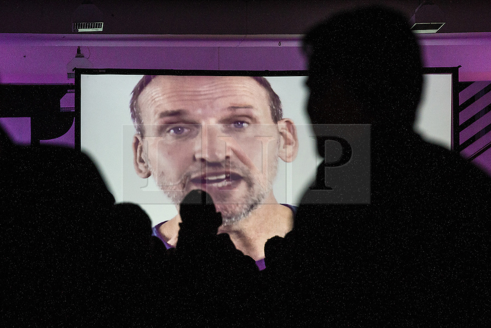 "© Licensed to London News Pictures . 14/08/2015 . Manchester , UK . People watch a recording of the tribute to Tony Wilson , "" St Anthony : an ode to Anthony H Wilson "" , featuring friends and colleagues (pictured CHRISTOPHER ECCLESTON ) of Tony Wilson lip syncing to Mike Garry 's poem , during a tribute at Old Granada Studios . Photo credit : Joel Goodman/LNP"