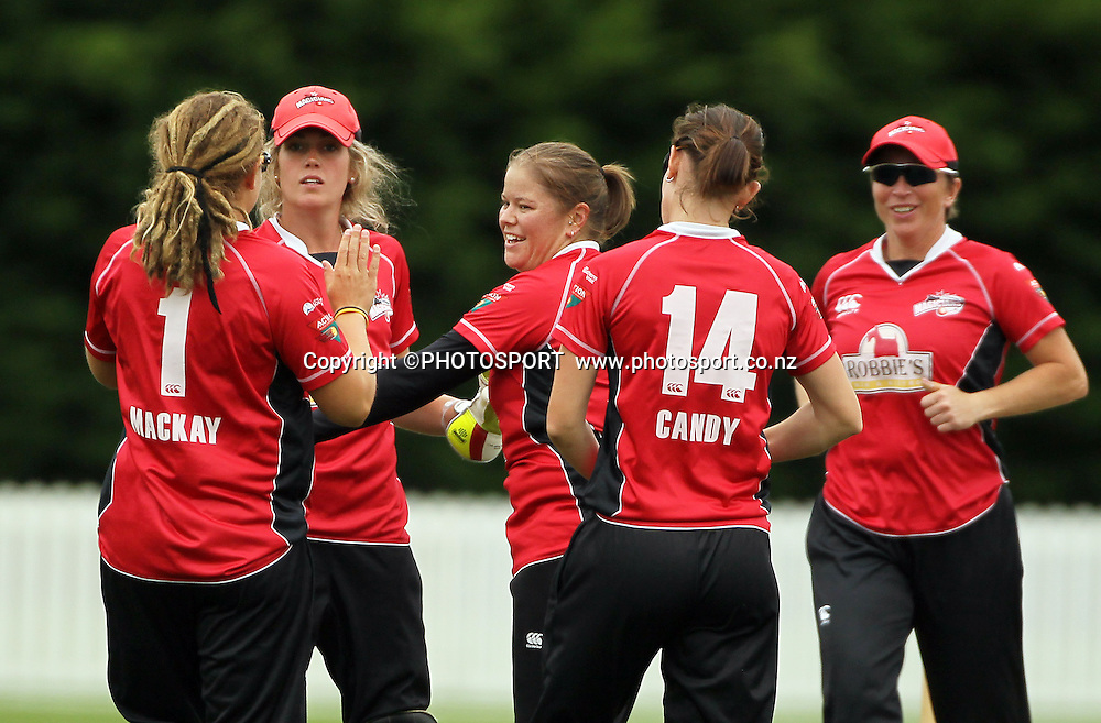 Kelly Anderson is surrounded by her Canterbury team mates after bowling Megan Wakefield for Wellington. Canterbury Magicians v Wellington Blaze. Action Cricket Twenty20, womens cricket match, Lincoln No. 3, Lincoln University, Thursday 29 December 2011. Photo : Joseph Johnson / photosport.co.nz