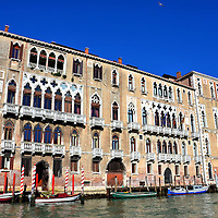 Cà Foscari and Giustinian Palaces in Venice, Italy <br /> On the left is the Palazzo Giustinian, a late Venetian Gothic palace that was built in the 15th century and once was the home of opera composer Richard Wagner.  Its neighbor along the Grand Canal is Ca' Foscari.  It's named after the Doge (or duke) of Venice who constructed it in 1453.  Henry III, a king of France, used to live here in the late 16th century.  It is now part of a university.