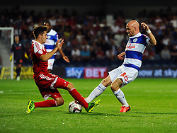 Queen Park Rangers' Andy Johnson and Swindon Town's Massimo Luongo  - Photo mandatory by-line: Seb Daly/JMP - Tel: Mobile: 07966 386802 27/08/2013 - SPORT - FOOTBALL - Loftus Road - London - Queens Park Rangers V Swindon Town -  Capital One Cup - Round 2