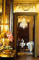 A dining room in the classic three star restaurant l'Ambroisie, Chef Bernard Pacaud- Place des Vosges, Paris - Photograph by Owen Franken