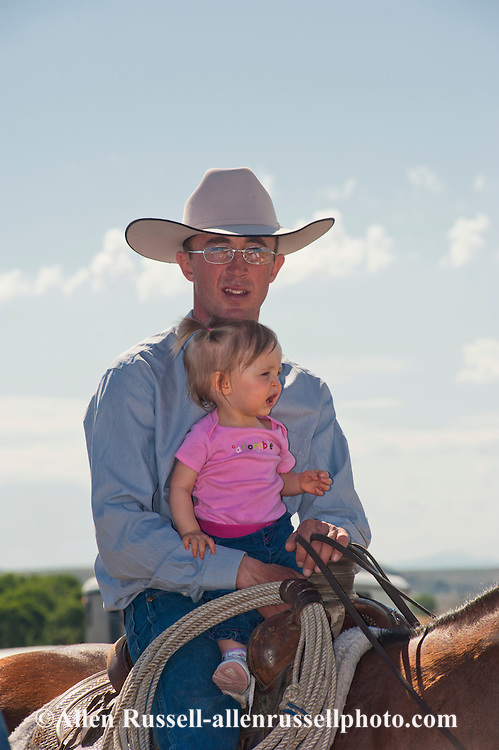 Cowboy, daughter, Wilsall Ranch Rodeo, Montana, David Fryer, Alexis Fryer, MODEL RELEASED, PROPERTY RELEASED