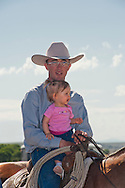 Cowboy, daughter, Wilsall Ranch Rodeo, Montana, David Fryer, Alexis Fryer, MODEL RELEASED, PROPERTY RELEASED