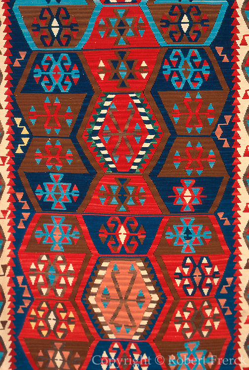 TURKEY, ISTANBUL colorful handmade woven textiles and  Anatolian carpets displayed in a craft  market shop