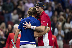 September 22, 2018 - Chicago, Illinois, U.S - Team Europe member ALEXANDER ZVEREV of Germany is congratulated by Team World member JOHN ISNER of the United States at the net after the first singles match between Team Europe and Team World on Day Two of the Laver Cup at the United Center in Chicago, Illinois. (Credit Image: © Shelley Lipton/ZUMA Wire)